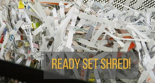 An image of shredded paper with the text 'Ready Set Shred' over it