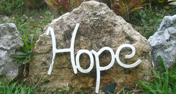 A rock with the word 'Hope'