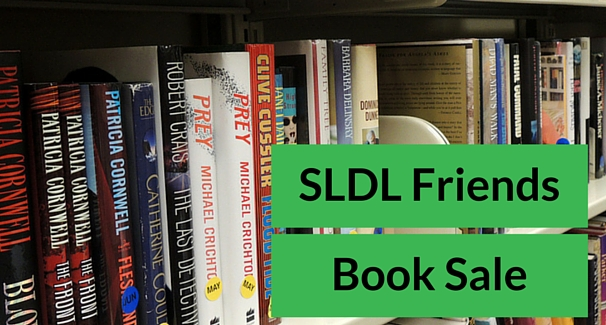 Image of books with the text 'SLDL Friends Book Sale'